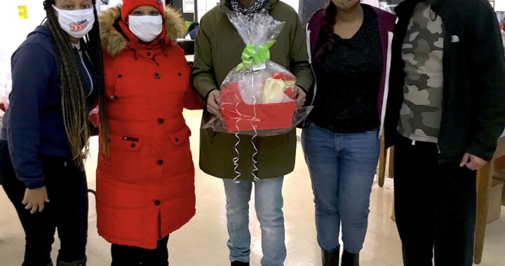 Local charter school gives out holiday food baskets